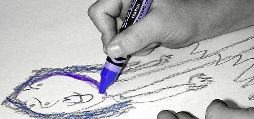 Child learning to draw